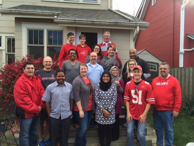 ACEL Graduate Student Association cheer the Buckeyes to victory at a autumn semester social hosted by Dr. Scott Scheer and his family.